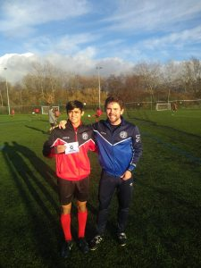 Marcos is presented with his prize by IHM Head Coach Matt