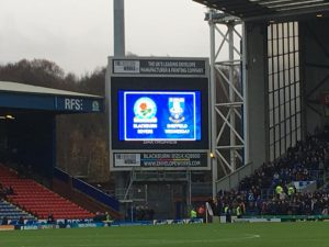 The large brightly coloured illuminated scoreboard in the corner of Ewood Park