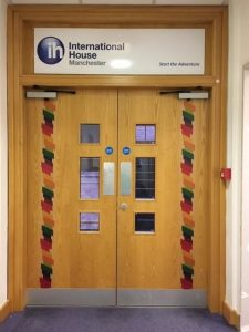 double exit doors with IH rainbow logo running down the edge of each door